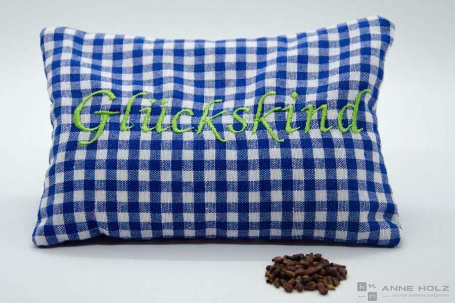 Traubenkernkissen-Glueckskind
